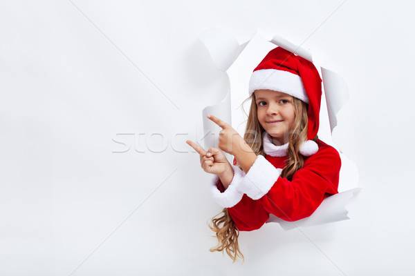 Girl in santa claus costume pointing to copy space Stock photo © ilona75