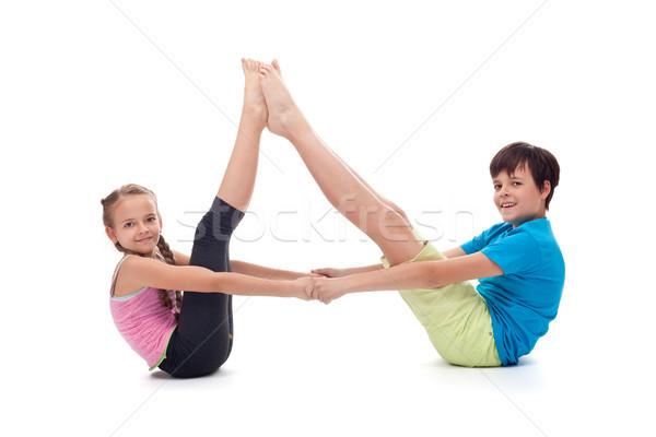 Kids balancing together sitting on the floor Stock photo © ilona75