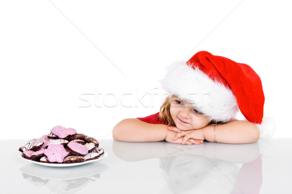 Little girl at christmas time with cookies Stock photo © ilona75