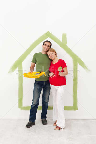 Couple expecting a baby redecorating their home Stock photo © ilona75