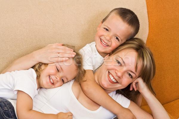 Enfants femme canapé fille heureux Photo stock © ilona75
