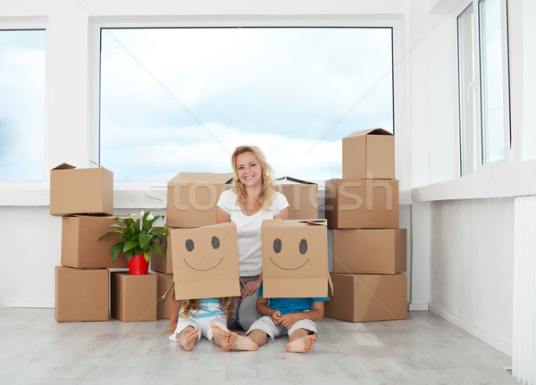 Woman with playing kids in their new home Stock photo © ilona75