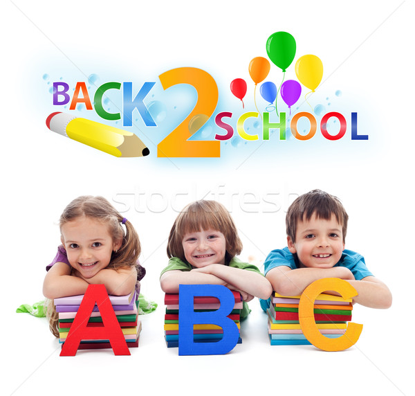 Stock photo: Back to school - kids with books and letters
