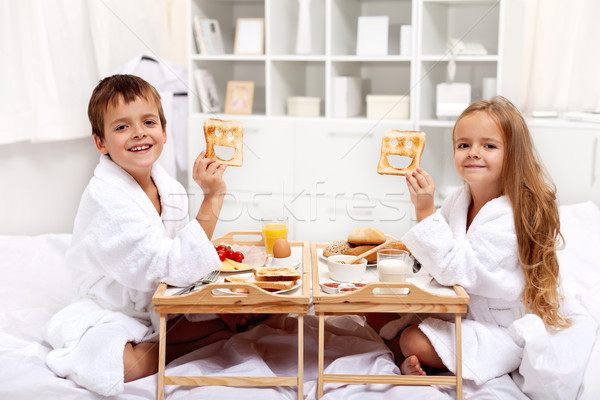 Breakfast in bed with happy kids Stock photo © ilona75