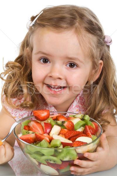 Heureux petite fille bol salade de fruits mixte Photo stock © ilona75