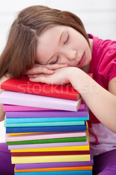 Exhausted young girl asleep on book stack Stock photo © ilona75