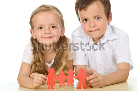 Stock photo: Sad kid cutting his paper people family