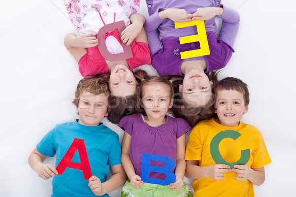 Group of kids holding alphabetical letters Stock photo © ilona75