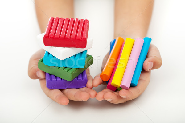 Child hands with colorful modeling clay Stock photo © ilona75