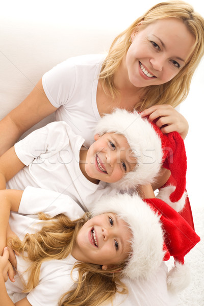 Happy kids and woman relaxing at christmas time Stock photo © ilona75