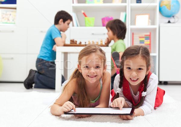 Oynayan çocuklar klasik tahta oyunları modern Stok fotoğraf © ilona75