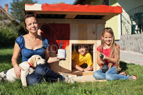 Happy kids painting the doghouse Stock photo © ilona75
