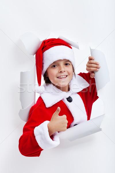 Happy boy opening christmas season Stock photo © ilona75