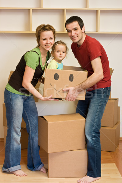 Happy family with a kid moving into a new home Stock photo © ilona75