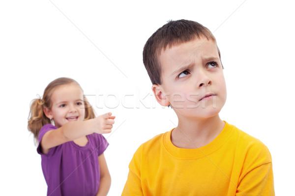 Bullying concept - girl mocking young boy Stock photo © ilona75