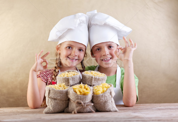 Kids with chef hats and pasta varieties - traditional food Stock photo © ilona75