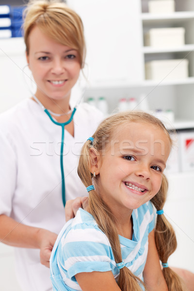 Stock photo: Little girl at the doctor for a checkup