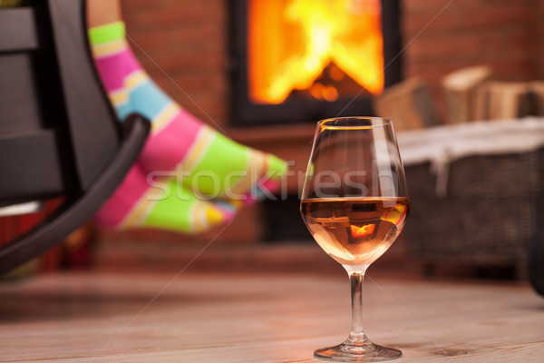 Woman with funny socks relaxing with a glass of wine Stock photo © ilona75