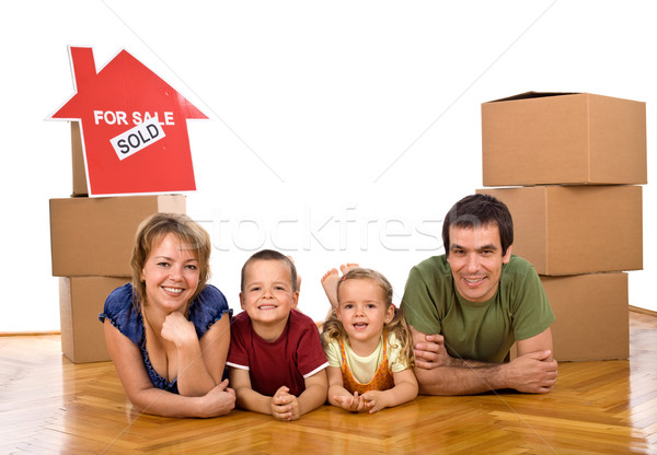 Stock photo: Happy family in their newly bought house