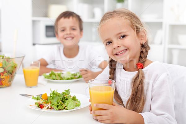 Enfants repas cuisine fille heureux Photo stock © ilona75