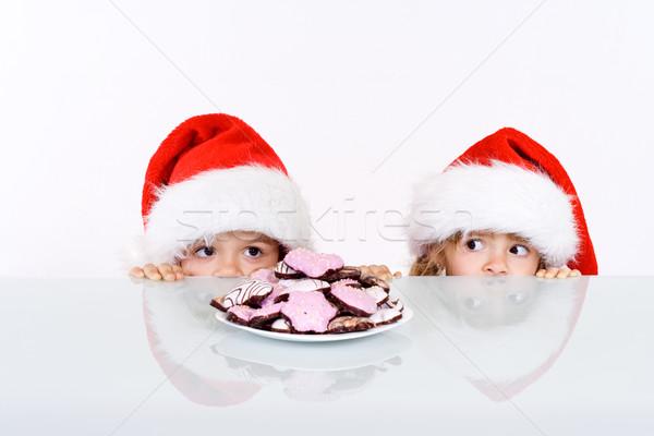 Kids lurking to get a glimpse of santa Stock photo © ilona75