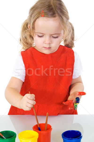 Little painter girl absorbed by the work Stock photo © ilona75