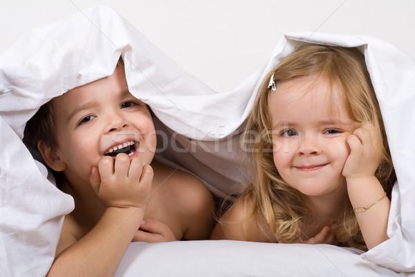 Ragazzi letto trapunta amore divertimento Foto d'archivio © ilona75