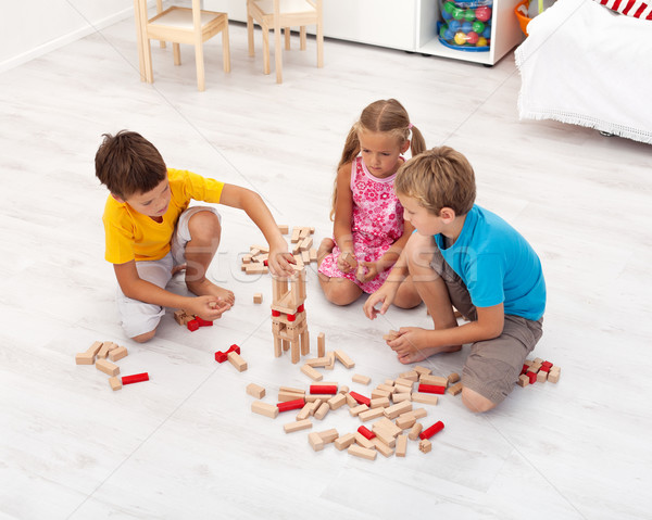 Kids playing with wooden blocks Stock photo © ilona75