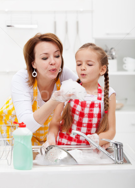 Woman and little girl washing dishes - having fun with the foam Stock photo © ilona75
