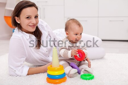 Playing with mom - baby girl at home Stock photo © ilona75