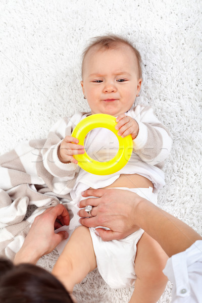 Changing diapers on a baby girl Stock photo © ilona75