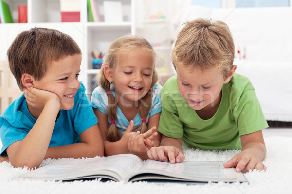 Kids having fun reading Stock photo © ilona75