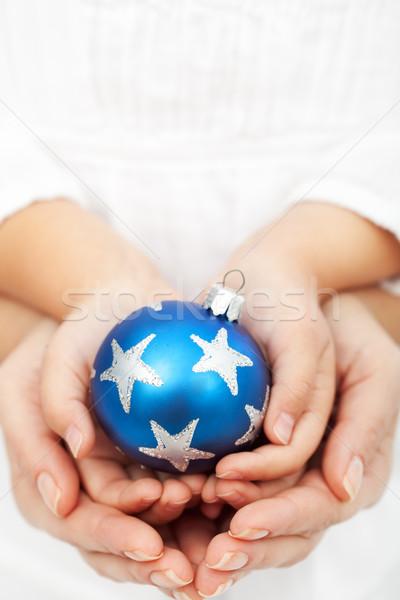 Hands holding christmas bauble Stock photo © ilona75