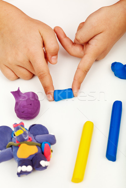 Child hands with colorful clay Stock photo © ilona75