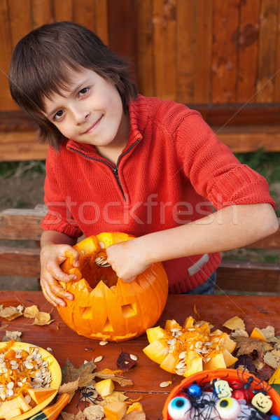 Boy preparing for Halloween - carving a jack-o-lantern Stock photo © ilona75