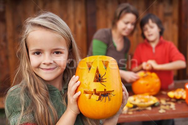 Little girl showing her Halloween jack-o-lantern Stock photo © ilona75