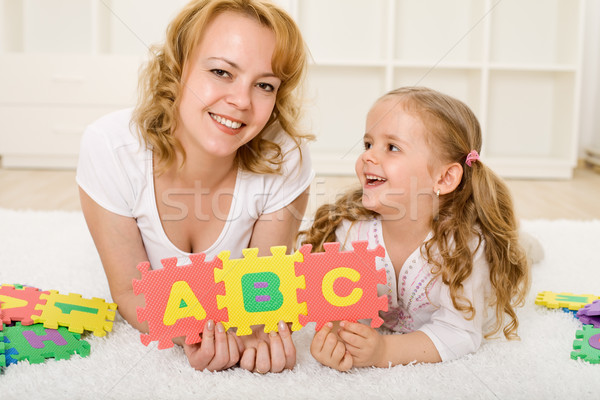 Stock photo: Little girl preparing for school playing and learning