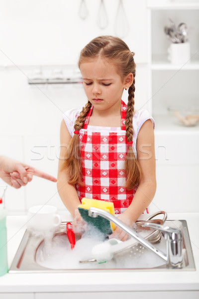 Do the dishes this instant - child ordered to wash up tableware Stock photo © ilona75