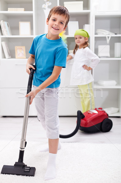 Stock photo: Kids cleaning the room - using a vacuum cleaner