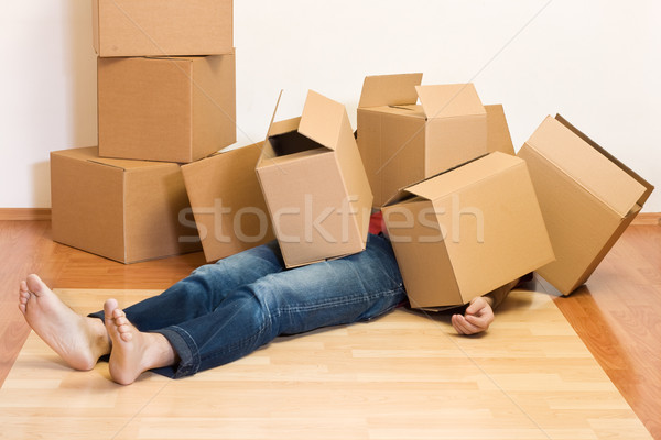 Man covered in cardboard boxes - moving concept Stock photo © ilona75