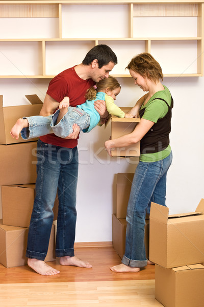 Family unpacking from lots of cardboard boxes Stock photo © ilona75