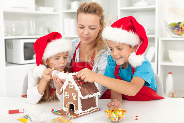 Happy family at christmas time in the kitchen Stock photo © ilona75