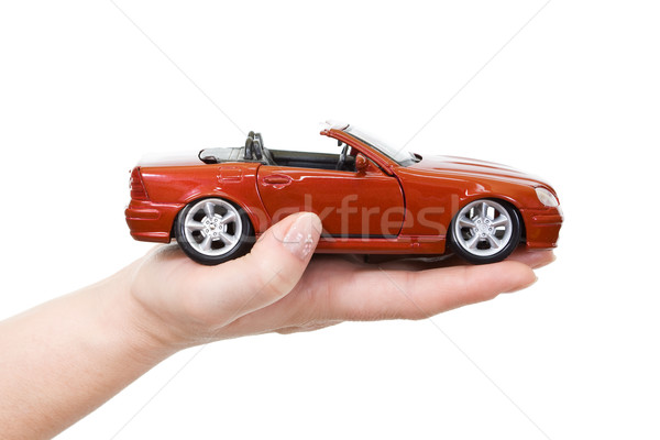 Nő kéz tart piros sportautó üzlet Stock fotó © ilona75