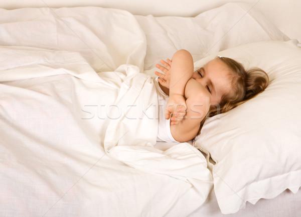 álmos kislány fektet ágy szem arc Stock fotó © ilona75