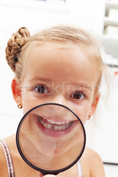 Happy girl with missing milk tooth Stock photo © ilona75