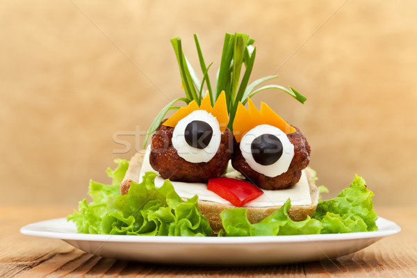 Funny meatball sandwich with vegetables Stock photo © ilona75