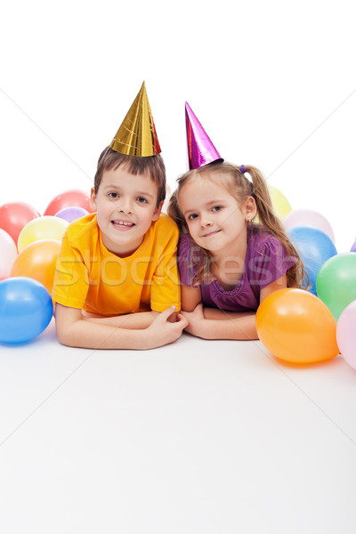 Kids with party hats and balloons Stock photo © ilona75