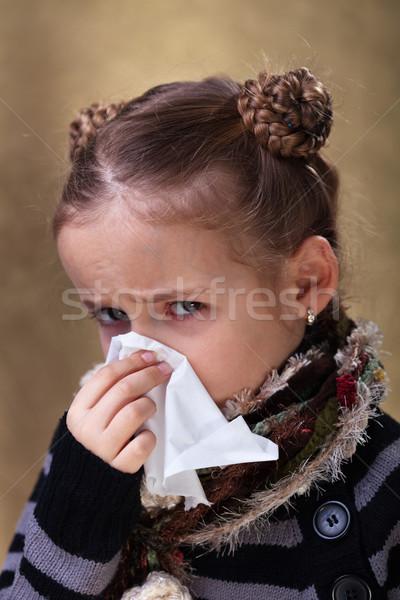 Little girl in flu season - blowing nose Stock photo © ilona75
