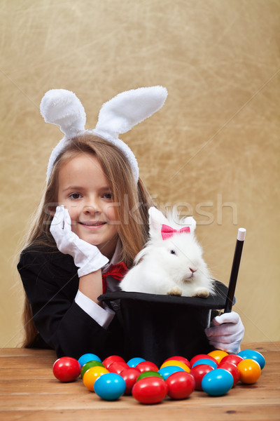 Young magician after successfully conjuring an easter rabbit Stock photo © ilona75