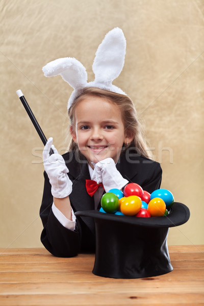 Happy magician girl making easter eggs with her powers Stock photo © ilona75